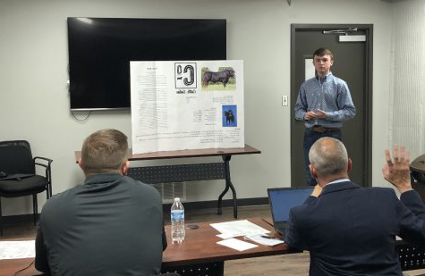 Freshman Tanner Werth presents his company Cattle.Online to panel of judges during the 2020 Ellis County Youth Entrepreneur Challenge. Twenty-five students competed in the event.